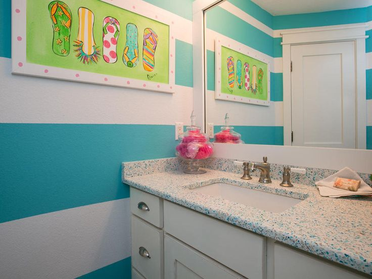 Second of Limefish's four bathrooms - Limefish's sea theme continues even when you're brushing your teeth! Its bright, playful colours throughout make this beach side villa  distinct.