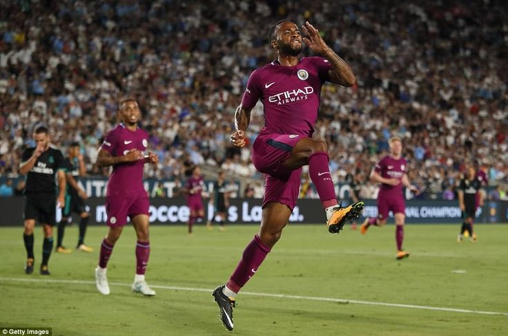 Raheem Sterling is clearly delighted after doubling City's advantage by firing the ball pa...
