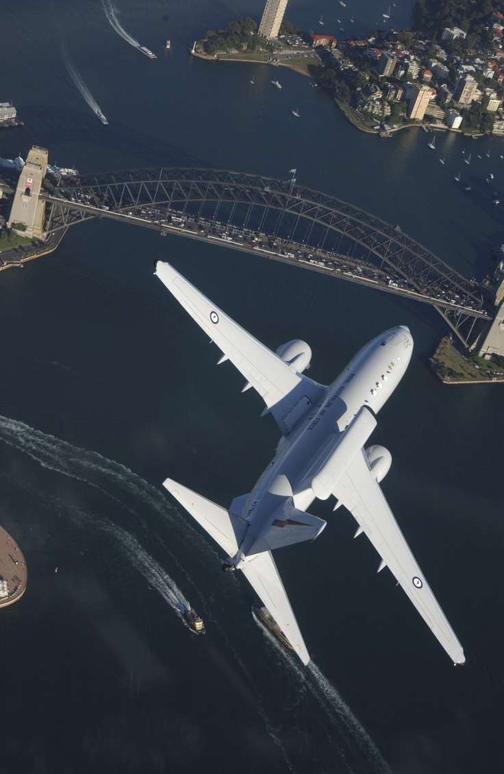 A 2SQN Wedgetail AWACS (Airborne Early Warning and Control) Aircraft flying over Sydney Harbour Bridge Australia