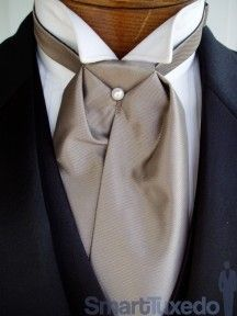 A taupe colored silk cravat tie. Not all cravats were of silk some were of white muslin, lace, ribbon, fine linen, cotton, laces, white cashmere, and a plaid scarf!