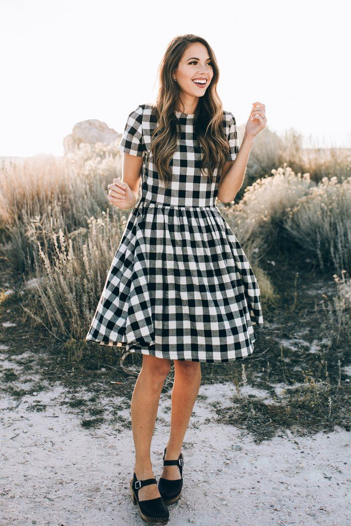 Short sleeves, a flowy skirt, and a gingham pattern make up this Check Party Dress. The relaxed fit will allow for total freedom of movement no matter if you're sitting by the bonfire or checking out