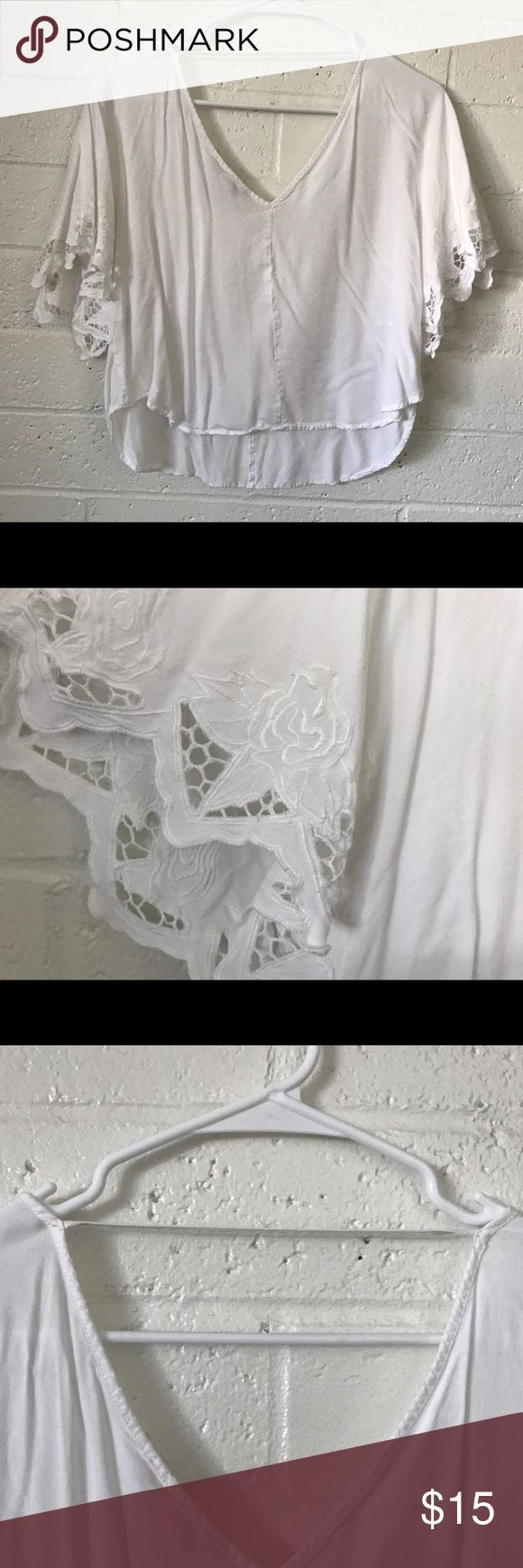 White lace shirt Lace on baggy sleeves, strap of fabric across scooped back. Tops Blouses