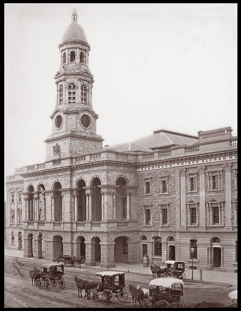 Adelaide Town Hall and Aldridge's Prince Alfred Hotel, c1890 from original albumen print by Sweet, 5 x 7 inches Adelaide Town Hall is a landmark building on King William Street in Adelaide, South Australia. The structure was designed by Edmund Wright and Edward Woods, with construction commencing in 1863 and completed in 1866. The tower is named after Prince Albert and the clock was installed in 1935