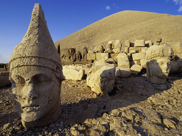 Nemrut is a 2,134 meter  high mountain in southeastern Turkey, near the city of Adiyaman. In 62 BC, King Antiochus I Theos of Commagene built a tomb-sanctuary flanked by huge statues of himself, two lions, two eagles and various Greek, and Persian gods on the mountain top