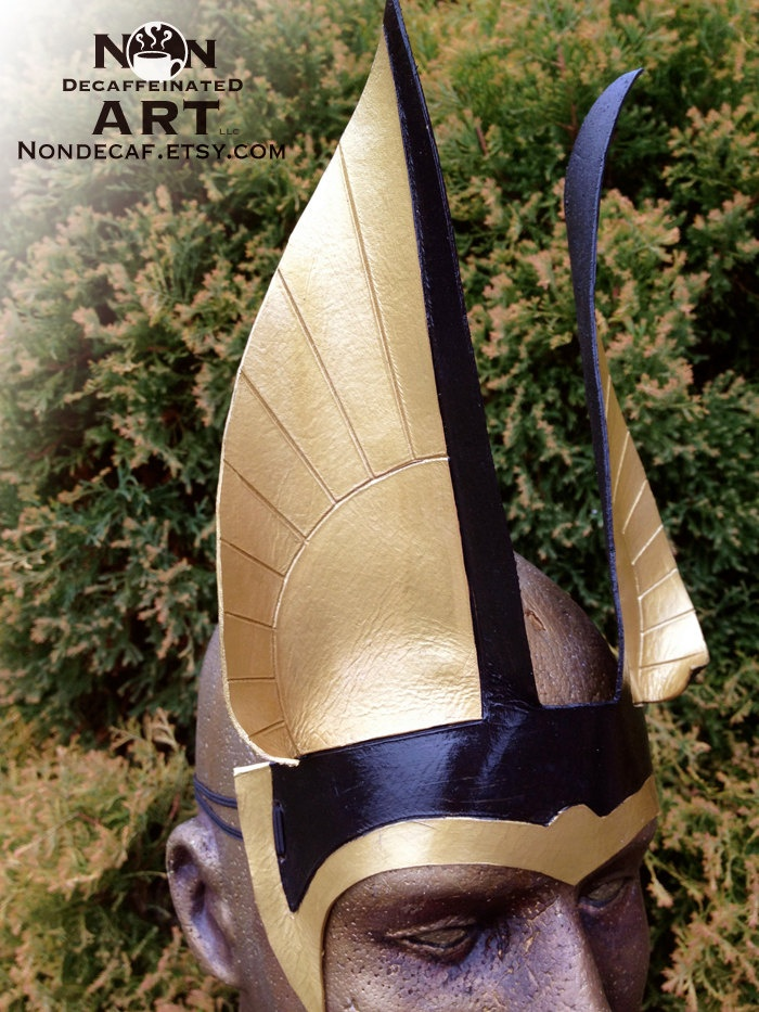 Egyptian inspired Handmade Leather Headdress Anubis Ears in Black and Gold with gem color of your choice. $42.00, via Etsy.