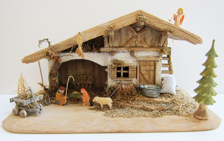 German Crib - Nativity - Krippen - Creche Set: Stable, Helbig Figures, German Accessories. Exquisite hand-carved Bavarian Stable. Nativity figures from the Helbig Workshop in the Erzgebirge, Germany. Hand-made accessories from Bavaria. One hand-carved and one hand-shaved tree from the Erzgebirge. A one-of-a-kind nativity set. Visit www.mygrowingtraditions.com for this and other nativity sets.