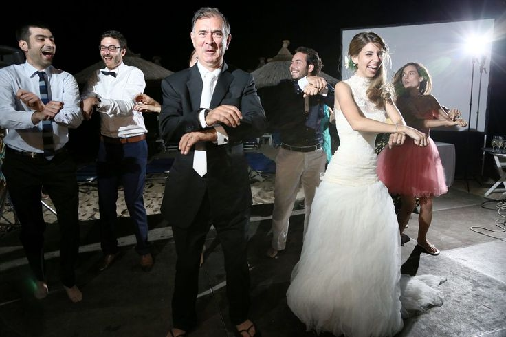 Father of bride,bride,best man and groom in wedding party at Chalkidiki Greece.