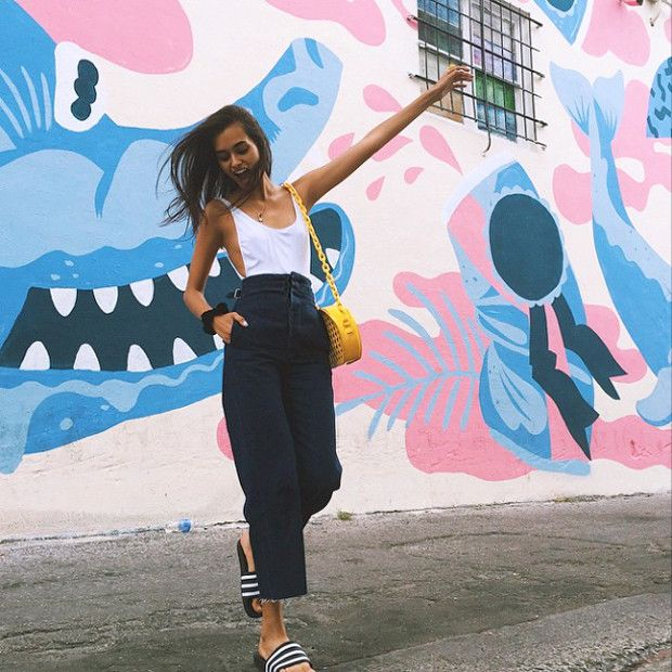 Gizele Oliveira OOTD: Flares & Adidas Slides   For more ideas, click the picture or visit www.thedebrief.co.uk