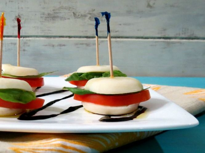 A cheesy, Italian style appetizer made with Mozzarella cheese, basil and tomato and drizzled with balsamic dressing and olive oil.