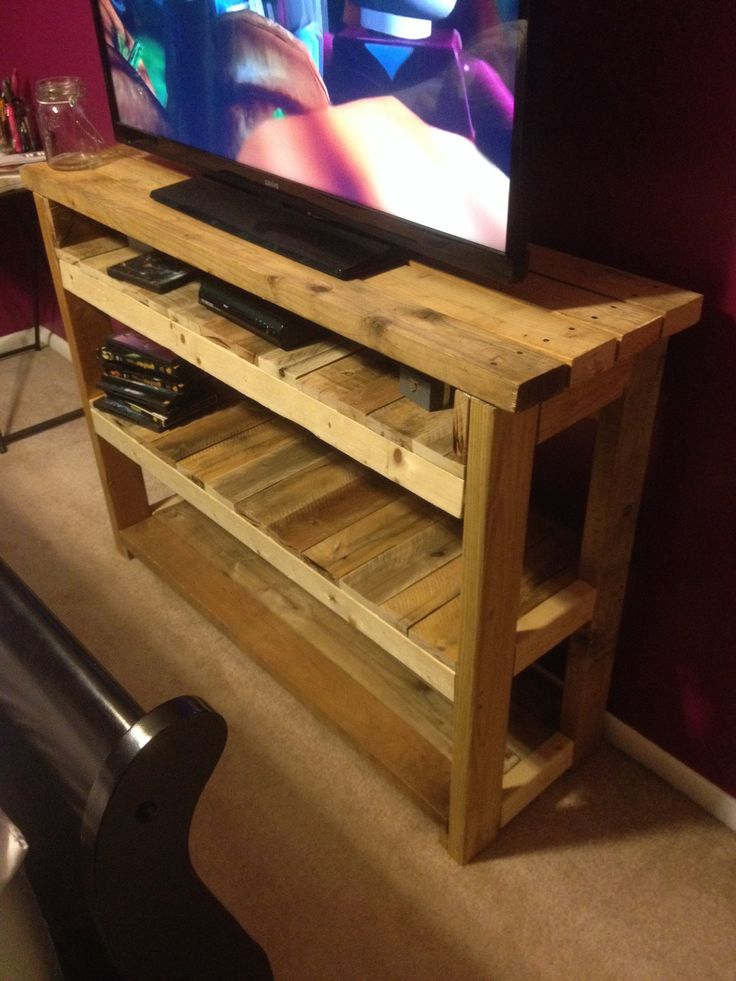 My first DIY tv stand with the help of my handy friend Michael. Made from four pallets with re addition of three 2x4's and two 2x3's. It just has to be stained.