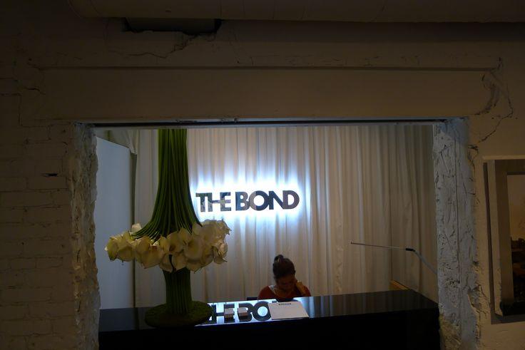 "The Bond condominium corporate logo signage 1"" acrylic with artsigns chrome custom finish installed on 6"" threaded rods illuminated on the back with LED lights#signage #office sign #sign company"