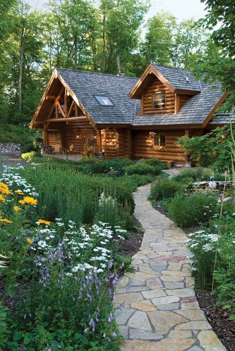 Love this stone walkway leading to a log cabin home.  This would be my dream home on a lake or in the mountains.