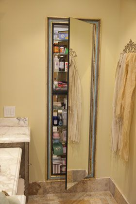 Bathroom: European architecture, old architecture, Spanish design, Mediterranean, Tuscan, Italian, French, European styles, California Ranch, full length decorative mirrored medicine cabinet, stone floor