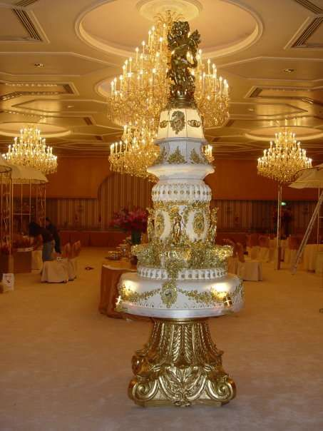 Gold and White Multiple-Tiered Over The Top Wedding Cake for the Bride and Groom who want to make a statement about their financial status-LOL!
