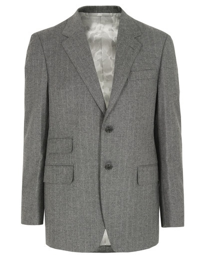 Mr. Bathing Ape – British, mens light grey three piece wool suit with a wide woven pinstripe and slim fit. The two button jacket features a notched lapel, single stand pocket, two flap closure hip pockets with signature jacquard camouflage print lining, four button cuffs and double rear vents. Internally the jacket is fully lined in grey jacquard camouflage print and finished with three pockets. £1370 at Coggles.com