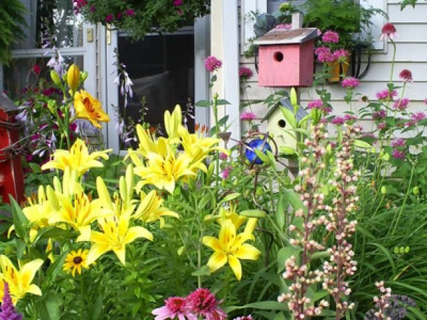 cottage gardens have a unique style all their own get tips on how to turn your garden space into a cottage design and learn which plants work best to
