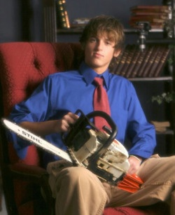 """The awkward senior portrait dilemma; A """"Trust Me"""" tie...and a Chainsaw, this kid is gonna be one Amazing politician."""