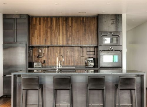 Combination of wood, concrete, and steel for a very masculine kitchen