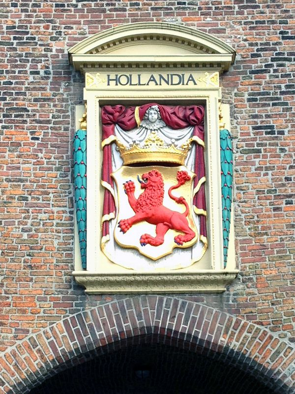 SOUTH HOLLAND FACTS & FIGURES -Find out about the geography, population, business environment and major event venues in the Province.  Photo: Hollandia cote-of-arms in stone sits above the Prison Gate archway in The Hague