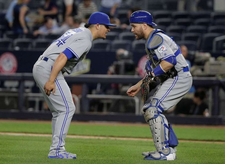 Dancing blues: Toronto Blue Jays pitcher Roberto Osuna (54) does a dance with catcher Russell Martin after the Blue Jays beat the New York Yankees 8-4 on May 25 in New York.