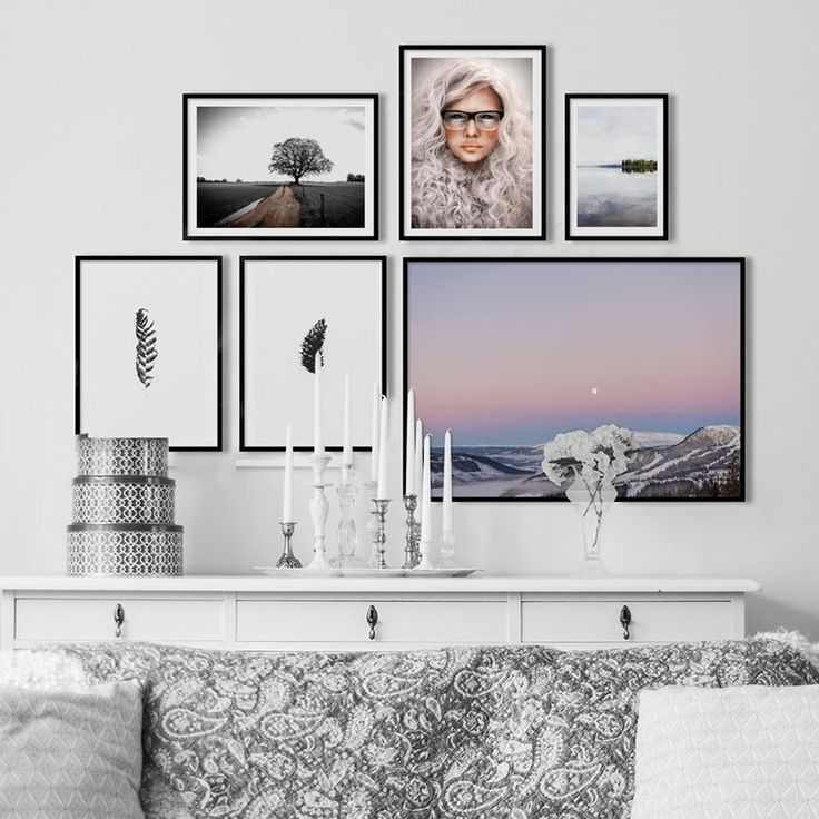 Calm photo wall with portraits, colorful and minimalistic posters from Printler, the marketplace for photo art. White and clean interior design.