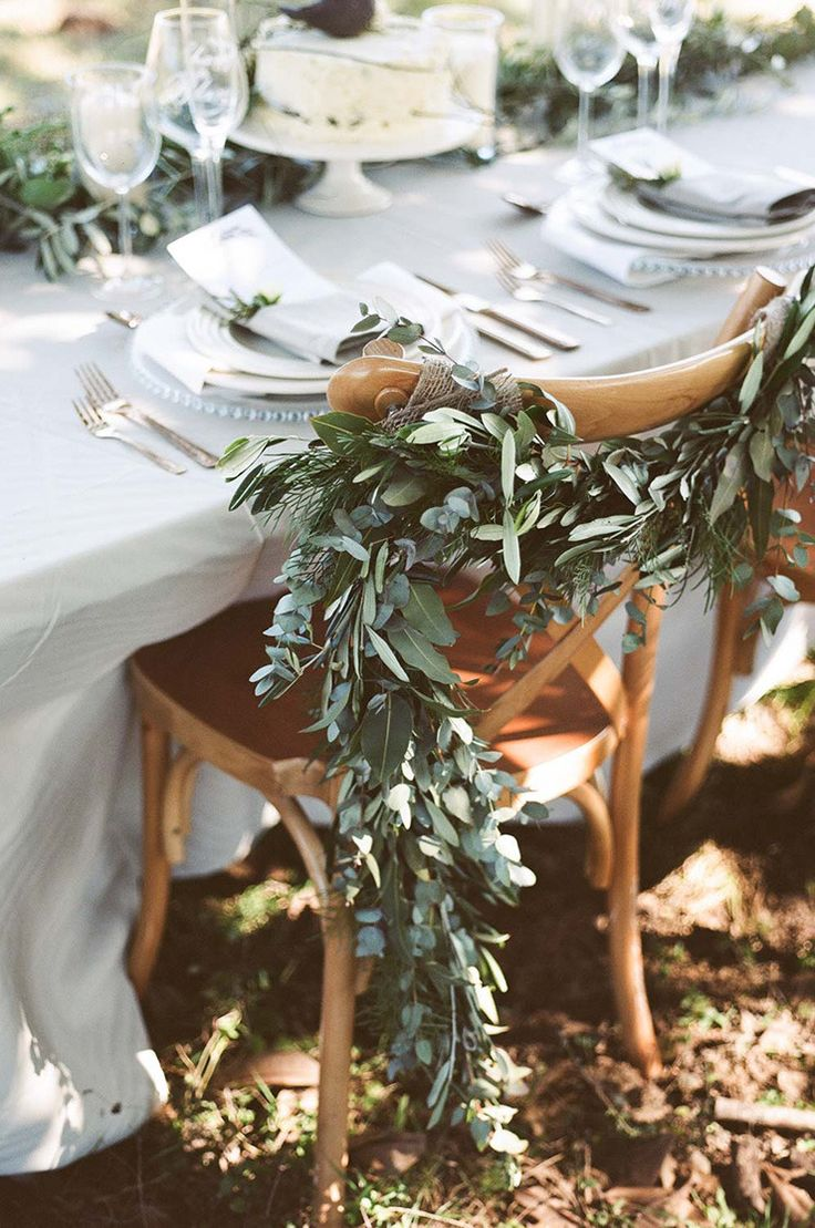 Rustic reception chair garland for olive grove wedding | Josie Richardson Photography