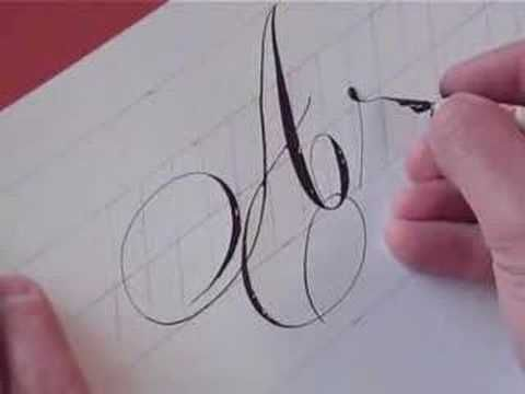 """Watch this quick demo of pointed pen Copperplate.  Notice, Hamid is lettering this without letting his hand touch the paper (or it will smudge).  He is working at a very large size, as well.  By exerting pressure on the flexible nib, he gets thick lines, by releasing, and barely touching the paper, he gets extremely thin """"hairlines.""""  This takes a great deal of control."""