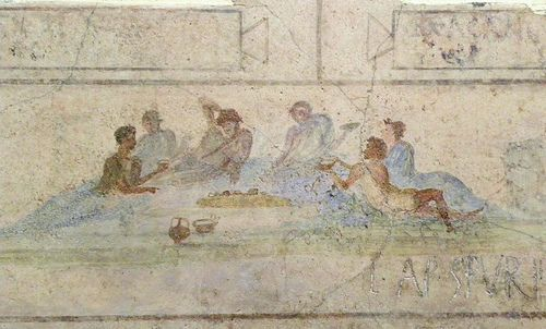 Symposium scene | A symposium (dinner party), from a painted frieze from a small mausoleum (colombarium) near Porta Maggione. The mausoleum was owned by the family of T. Statilius Taurus, an aristocrat close to the emperor Augustus. Dated ca. 25-1 BC.