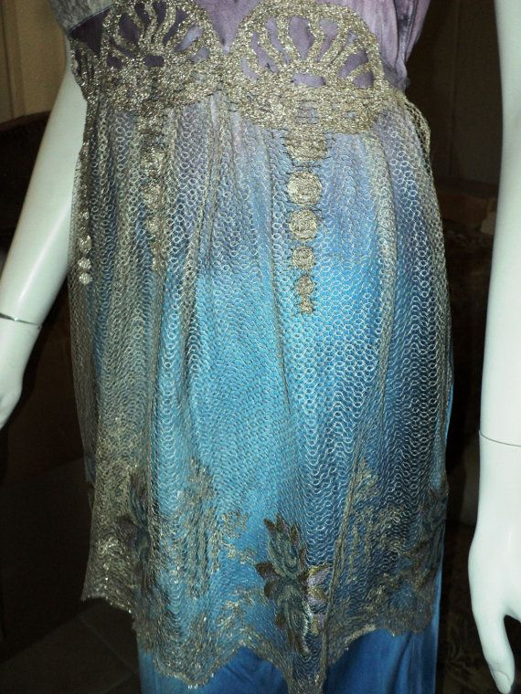 Just listed, Lavendar Wystieria a Bellasoiree Original dress. Edwardian Style, one of a kind silk and lace 1920s chemise which is ombre dyed from lavendar to French Blue. It is long and is trimmed at the bottom with a Turn of the Century Silver Metallic Torchon lace. The bodice is lovely and features an Art Nouveau metallic tulle floral applique. Various shades of moss, silver, blue and lavender threads are meticulously created which is repeated in the apron. Metallic silver embroidered silk…
