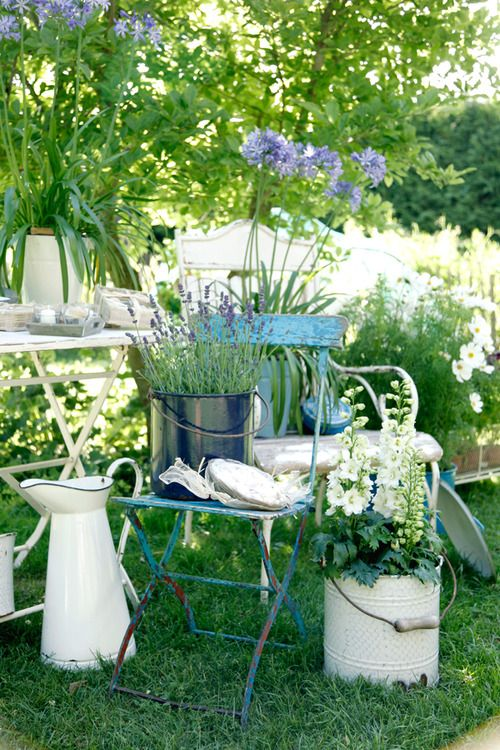 Adding vintage enamel containers and chair for a nice homey garden look.