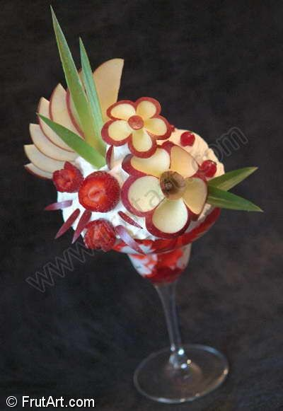 Wow! Fruit carved on a dish of ice cream