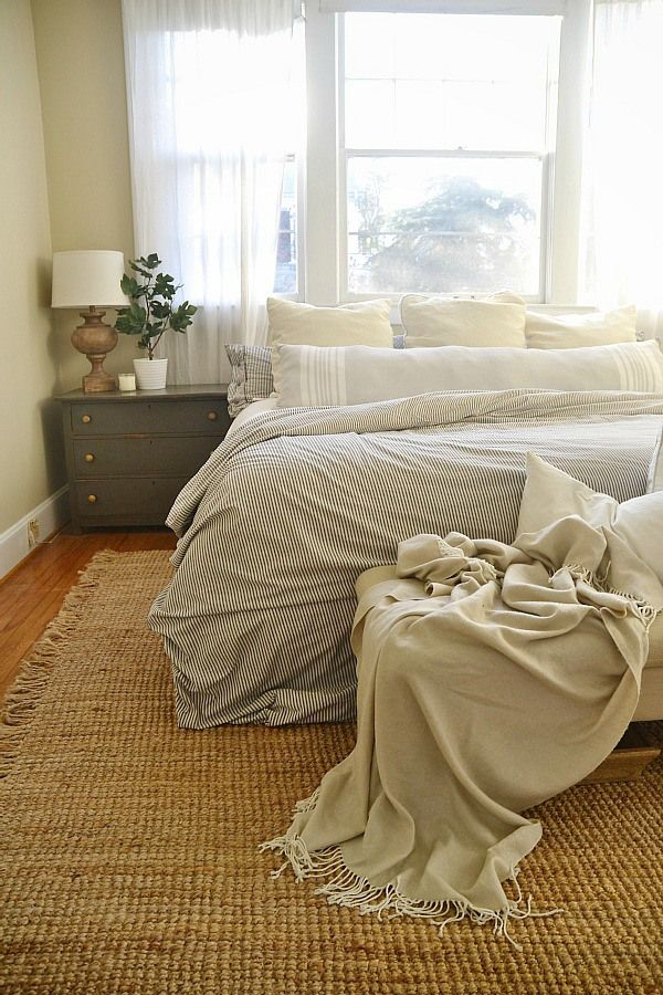 Bright & Light Master Bedroom - LMB Rental - night stands in urbane bronze, striped duvet from ikea