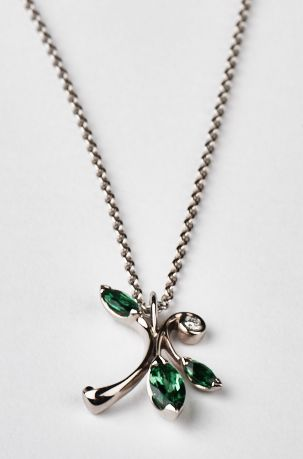 Our lovely Floral pendant, in 18ct Fairtrade white gold set with tsavorite garnets.  These are incredibly lively, bright and beautiful green garnets.  #Fairtrade #garnet #finejewellery #whitegold