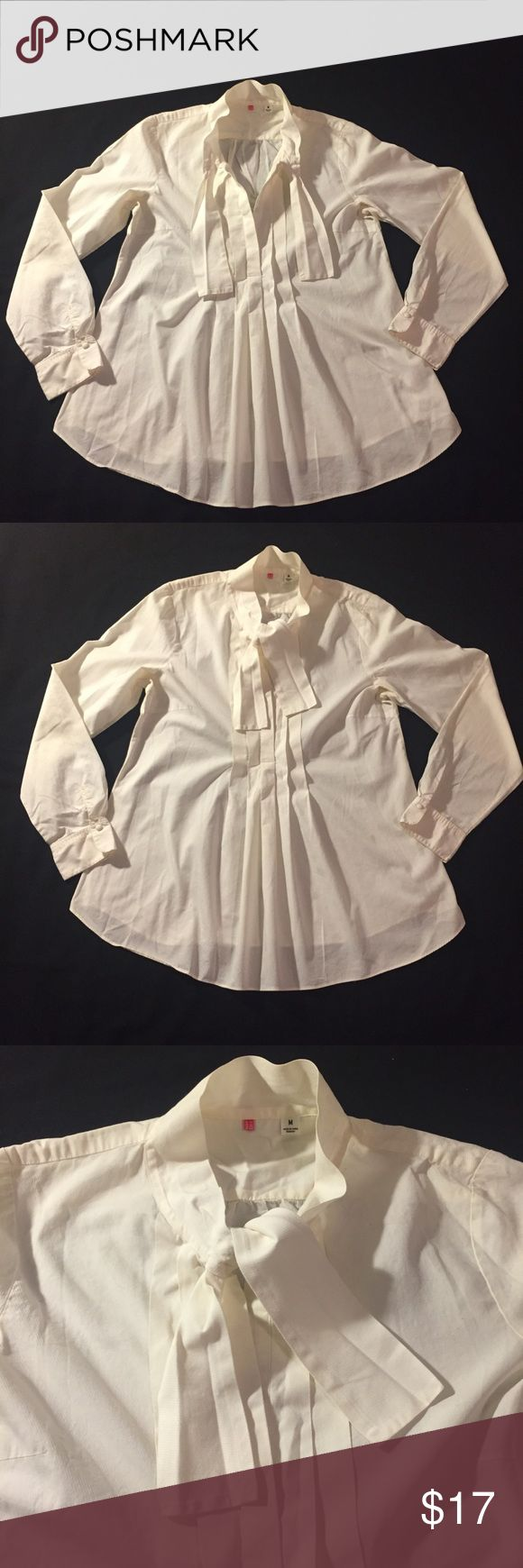 "UNIQLO Crisp Pleated BOHO Poets Blouse / Tunic Crisp Cotton Twill - Awesome White Shirt with Neck Tie Detail and pleated Front Great Condition - worn only 2 or 3 times Pit to pit 19"", length 27"" - more volume towards the bottom due to pleats This is awesome loose over shorts and boots, or elegant buttoned up and tucked into a pencil skirt..  smoke free household Uniqlo Tops Tunics"