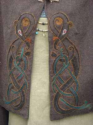 Detail of dragon embroidery on one of Maria Åhren's rectangular cloaks.