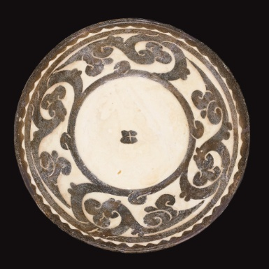 A Small Nishapur or Samarqand Dish with vegetal decoration, Eastern Persia or Central Asia, 10th century - Sotheby's