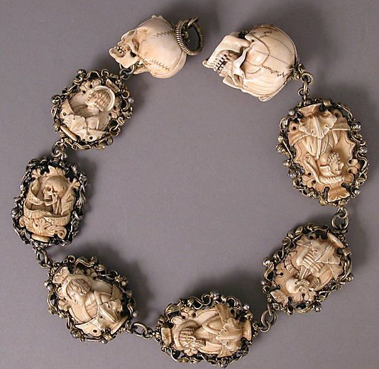 "Nothing says ""Merry Christmas"" like chain of skulls. It's a very jolly rosary. Germany 1500-1525. Iron, silver and gilded mounts."