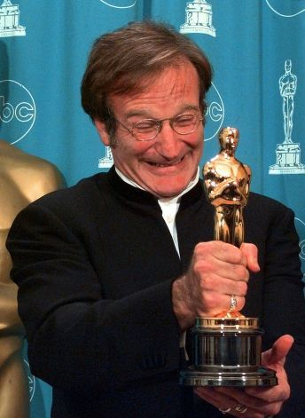"Robin Williams shows off his Oscar for Best Supporting Actor for ""Good Will Hunting"" at the 70th Academy Awards at the Shrine Auditorium in ..."