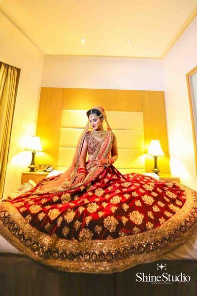 Bridal Lehenga - Bride in a Marsala Velvet Lehenga with Golden Embroidery   WedMeGood #wedmegood #indianbride #indianwedding #lehenga #bridal #bridallehenga #indianlehenga #marsala #velvet