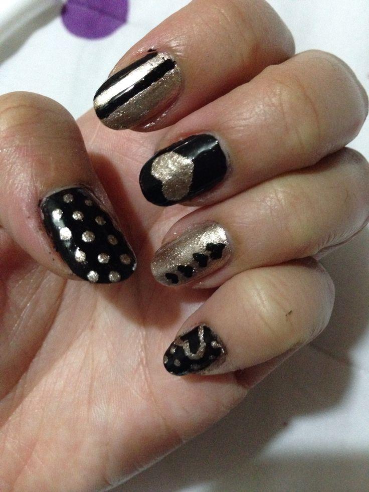 Uñas negro y dorado