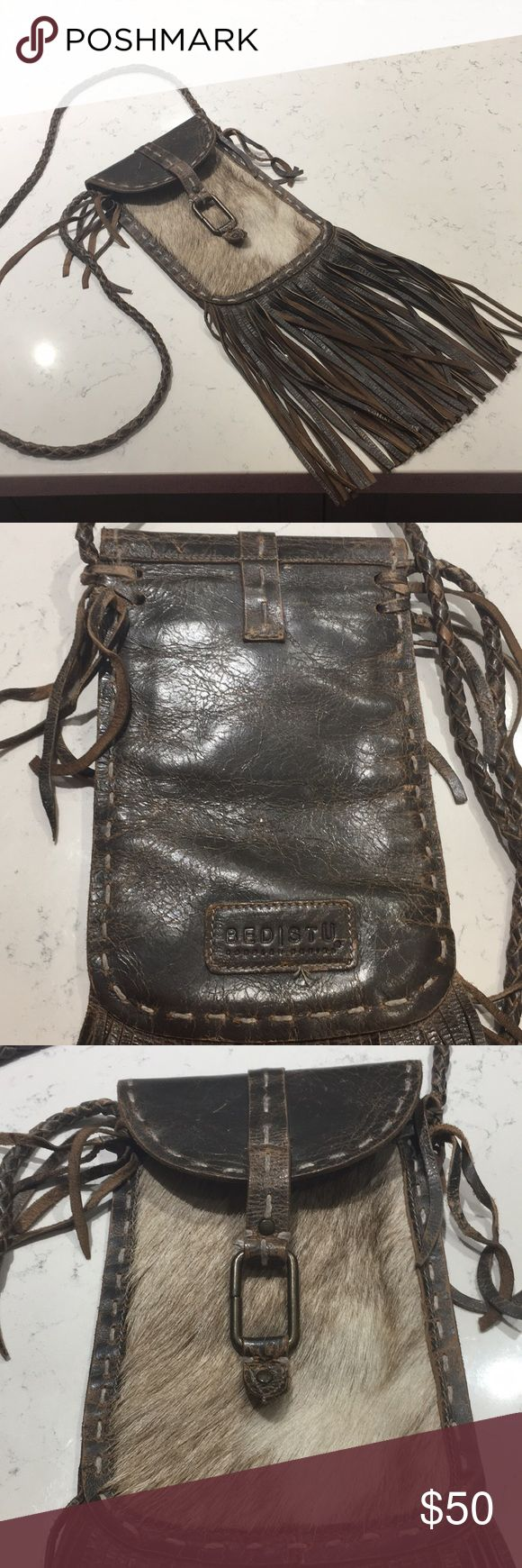 Bed Stu Cowhide Fringe Crossbody Super cute! Great for festivals or even coachella. Inside is tight. Can only fit phone, keys, and cards. Has a zip pocket and card pocket inside. Not an adjustable strap. Hangs down to mid-thing. REAL leather and cowhide Bed Stu Bags Crossbody Bags