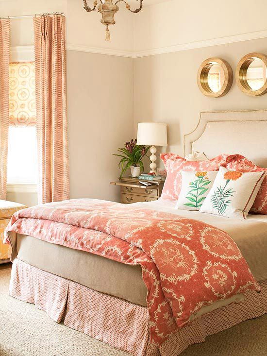 Moving Theme: A thread of reddish-orange unites the patterns in this bedroom, but if you look a little closer, you'll also discover a subtle circle motif. Dots on the bed skirt and draperies, circles on the duvet cover, and rings on the Roman shades all work together to add movement to the space. The piece de resistance: a trio of porthole-style mirrors above the bed.