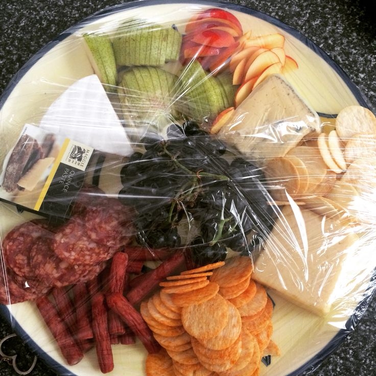 Cheeeese! Simple and easy way to doña cheese platter. Cheddar, soft and smelly cheese. Add fruit, like grapes, pears and grapes. Add some meat we aren't vegetarian. Ham or salami. Any type of dips. Olives for th daring character.