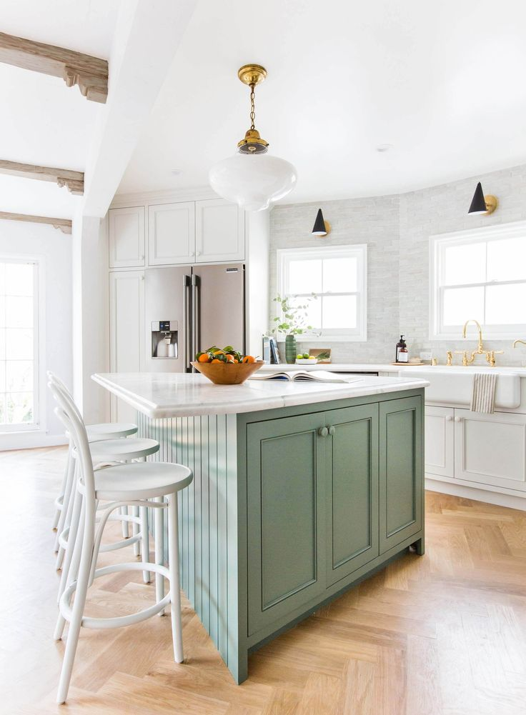 All white everything other than the green counters, with Wood as the accent color and a very light gray backsplash; like.