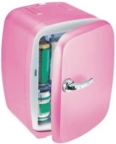 Pink mini fridge - so cute! I need one of these for my bathroom. To place my homemade sugar and salt scrubs in...and other homemade beauty mixes that need refrigeration.