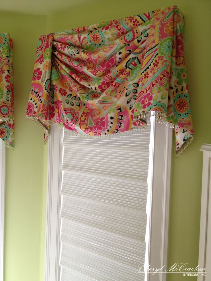 Teenage girls bedroom board mounted swag valance  with bead trim. A woven wood shade for privacy.