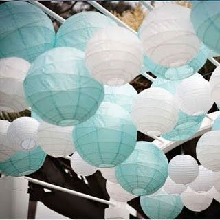 These white and baby blue lanterns clustered together to create a dense canopy…