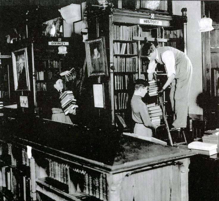"""""""Clifton College boys helping to move the library during the war."""" Bristol, World War II"""