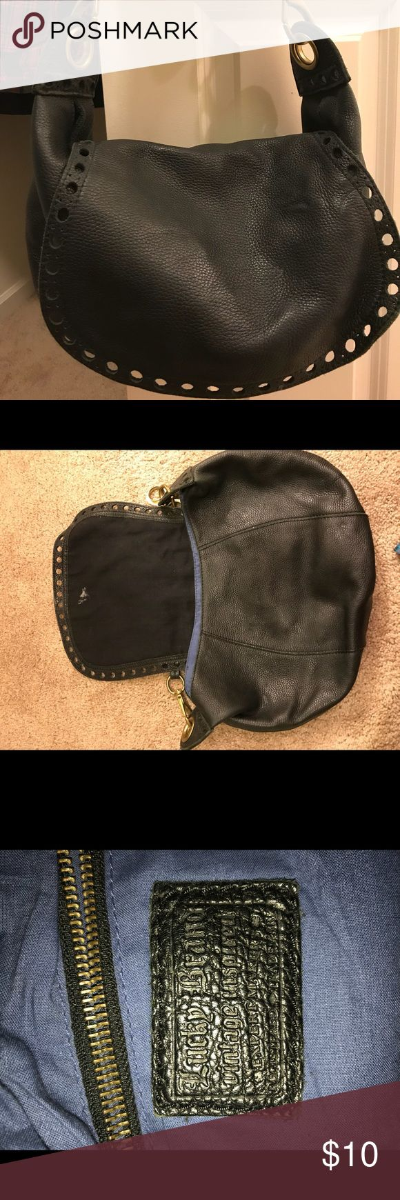 Lucky brand purse I've had it laying in my closet forever, it's a lucky brand vintage purse. It has a stain in the opening flap but other then that it's in great condition! Lucky Brand Bags Shoulder Bags