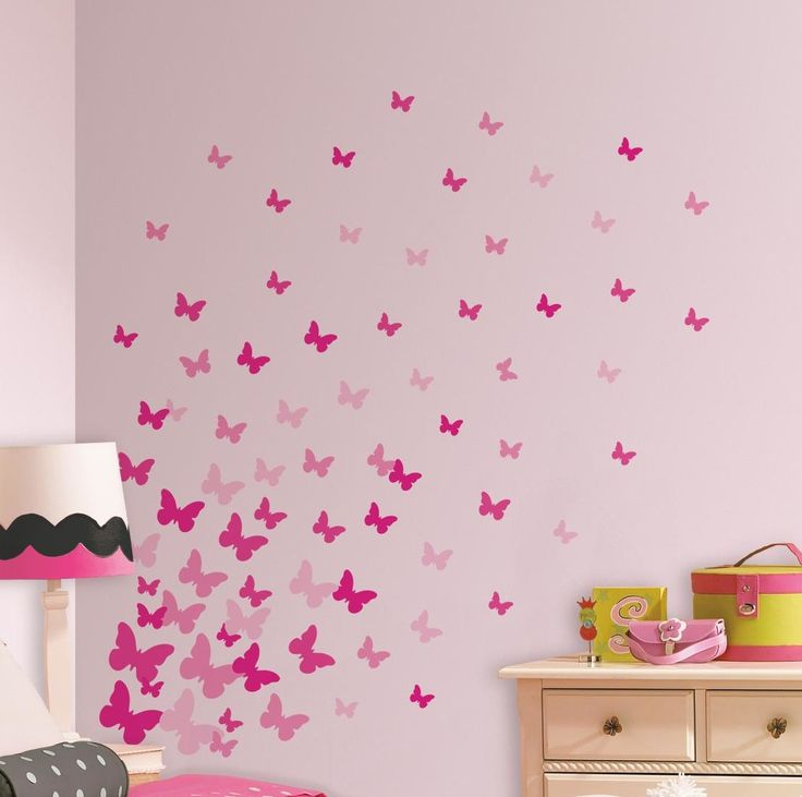Features:  -Material: Vinyl.  -Color: Pink.  -Self-adhesive.  -Studio designs.  -Surface washable.  -Made in the USA.  Product Type: -Wall decal.  Theme: -Insects.  Color: -Pink.  Compatible Surface T